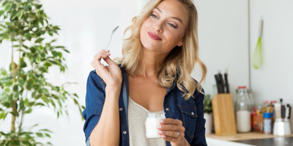 Woman Eating Greek Yogurt